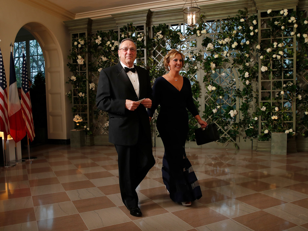 . Gov. Paul LePage, R-Maine, and Lauren LePage arrive for a State Dinner with French President Emmanuel Macron and President Donald Trump at the White House, Tuesday, April 24, 2018, in Washington. (AP Photo/Alex Brandon)