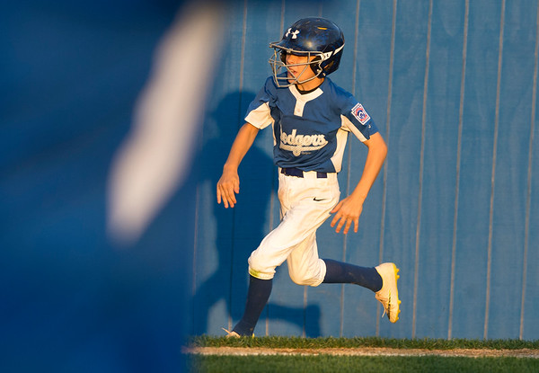 08/19/19 Wesley Bunnell | Staff The Forrestville Dodgers vs the McCabe-Waters Astros in the first game of the city series at Breen Field on Monday August 19, 2019. Dodgers Nate Johnson (7) rounds third base on his way to score.