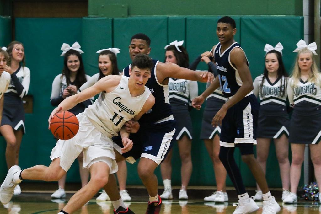. 2018 - Basketball - Benedictine at Lake Catholic.  Benedictine defeated Lake Catholic 63-56.  Lake Catholic\'s Luka Eller (11) tries to get around Benedictine\'s  Mario Caywood (11).