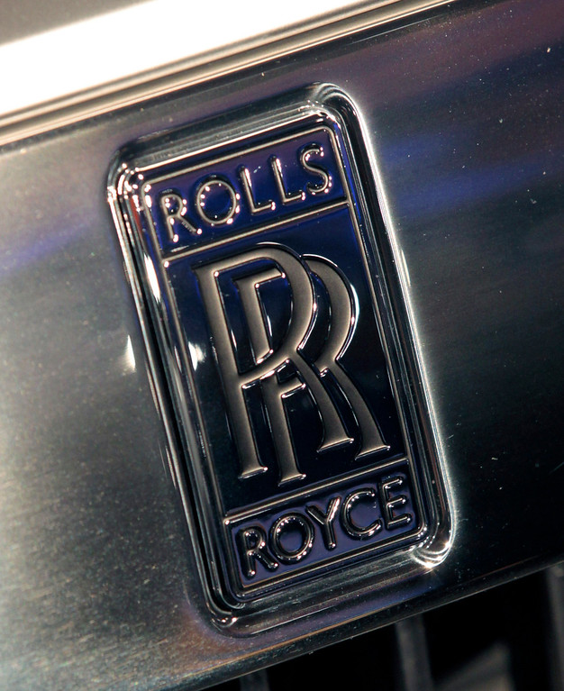 . The Roll-Royce logo is displayed on the Phantom luxury automobile, produced by Rolls-Royce Motor Cars Ltd., at The Gallery in the MGM Grand Detroit ahead of the 2013 North American International Auto Show (NAIAS) in Detroit, Michigan, U.S., on Saturday, Jan. 12, 2013. The Detroit auto show runs through Jan. 27 and will display over 500 vehicles, representing the most innovative designs in the world. Photographer: Jeff Kowalsky/Bloomberg