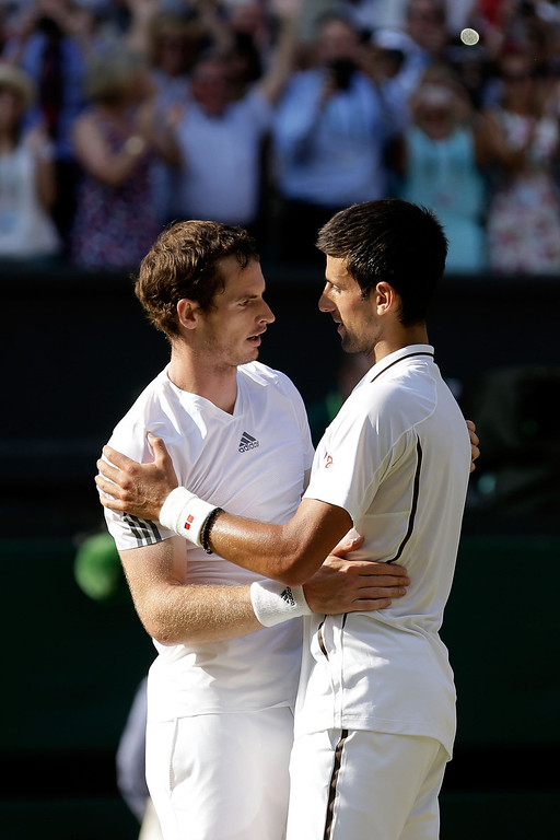 . Andy Murray of Great Britain is congratulated by Novak Djokovic of Serbia following his victory in the Gentlemen\'s Singles Final match against Novak Djokovic of Serbia on day thirteen of the Wimbledon Lawn Tennis Championships at the All England Lawn Tennis and Croquet Club on July 7, 2013 in London, England.  (Photo by Anja Niedringhaus - Pool/Getty Images)