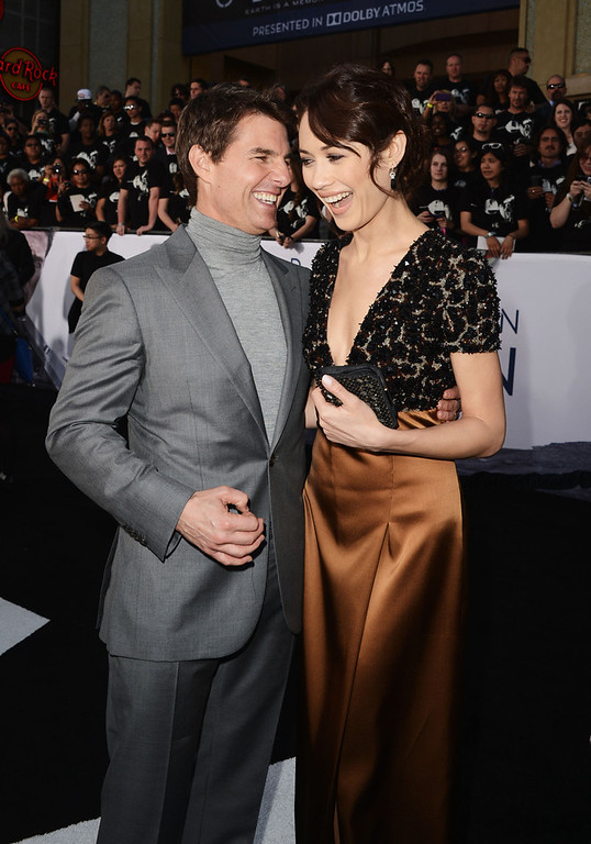 """. Actors Tom Cruise and Olga Kurylenko arrive at the premiere of Universal Pictures\' \""""Oblivion\"""" at Dolby Theatre on April 10, 2013 in Hollywood, California.  (Photo by Kevin Winter/Getty Images)"""