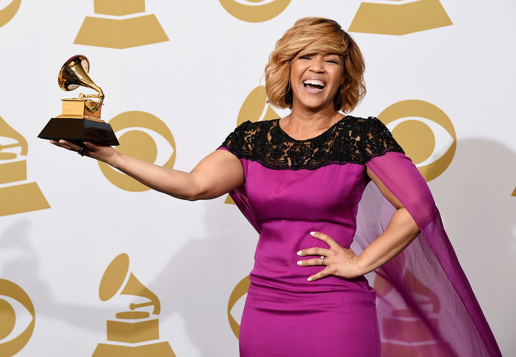 . Erica Campbell poses in the press room with the award for best gospel album for �Help� at the 57th annual Grammy Awards at the Staples Center on Sunday, Feb. 8, 2015, in Los Angeles. (Photo by Chris Pizzello/Invision/AP)