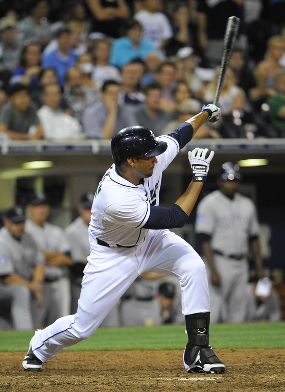 . SAN DIEGO, CA - SEPTEMBER 6:  Jesus Guzman #15 of the San Diego Padres hits a walk-off single during the ninth inning of a baseball game against the Colorado Rockies at Petco Park on September 6, 2013 in San Diego, California.  The Padres won 4-3. (Photo by Denis Poroy/Getty Images)