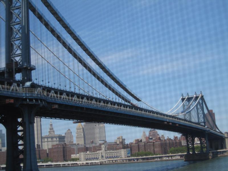 The Manhattan Bridge soaring across the river.