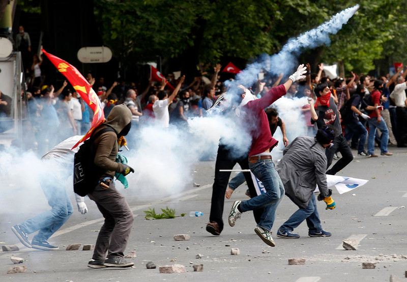 . Demonstrators clash with Turkish riot police during a protest against Turkey\'s Prime Minister Tayyip Erdogan and his ruling AK Party in central Ankara June 2, 2013. Erdogan accused Turkey\'s main secular opposition party on Sunday of stirring a wave of anti-government protests, as tens of thousands regrouped in Istanbul and Ankara after a lull and trouble flared again in the capital. Police used tear gas on protesters in Ankara but the clashes were relatively minor compared with major violence in Turkey\'s biggest cities on the previous two days. REUTERS/Umit Bektas