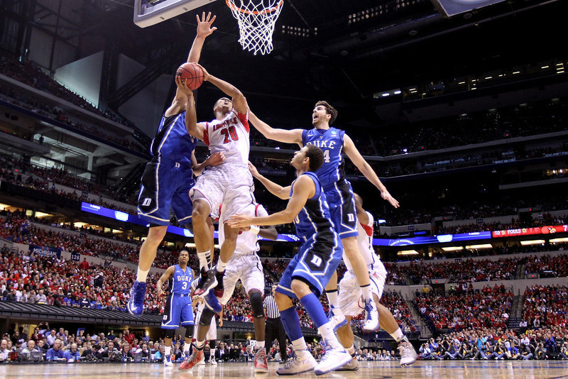 . Wayne Blackshear #20 of the Louisville Cardinals drives for a shot attempt in the first half against the Duke Blue Devils during the Midwest Regional Final round of the 2013 NCAA Men\'s Basketball Tournament at Lucas Oil Stadium on March 31, 2013 in Indianapolis, Indiana.  (Photo by Andy Lyons/Getty Images)
