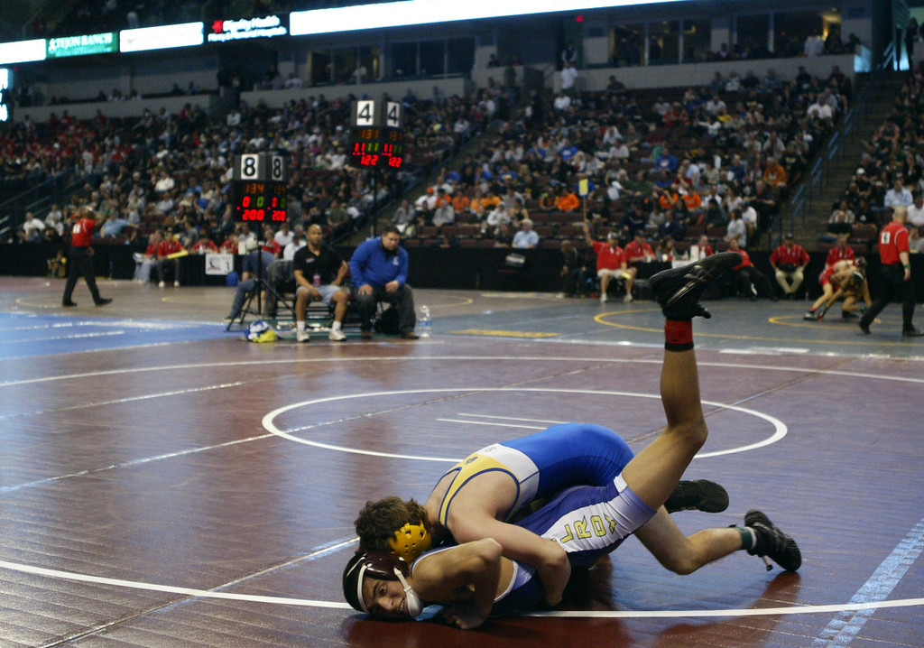 . Gilroy\'s Jesse Vasquez, bottom, wrestles Valencia\'s Jake Langenwalter in a 113-pound second round match during the California Interscholastic Federation wrestling championships in Bakersfield, Calif., on Friday, March 1, 2013. Langenwalter would go on to win the match. (Anda Chu/Staff)