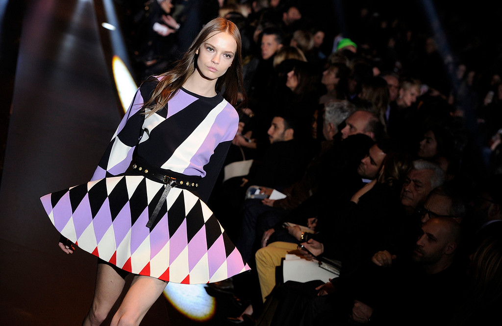 . A model wears a creation for Fausto  Puglisi women\'s Fall-Winter 2014-15 collection, part of the Milan Fashion Week, unveiled in Milan, Italy, Wednesday, Feb. 19, 2014. (AP Photo/Giuseppe Aresu)