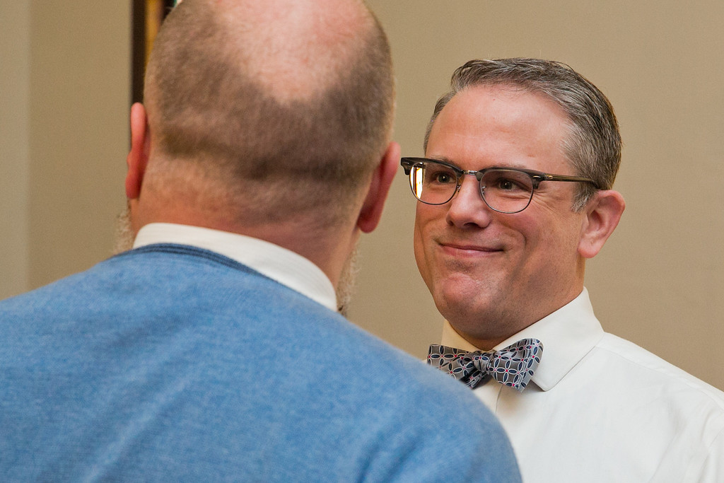 . Art Ledin-Bristol smiles at his soon-to-be-husband, Corey Ledin-Bristol, during their wedding ceremony at the Harbor Unitarian Universalist church in Muskegon, Mich., on Saturday, March 22, 2014. (AP Photo/The Chronicle, Natalie Kolb)