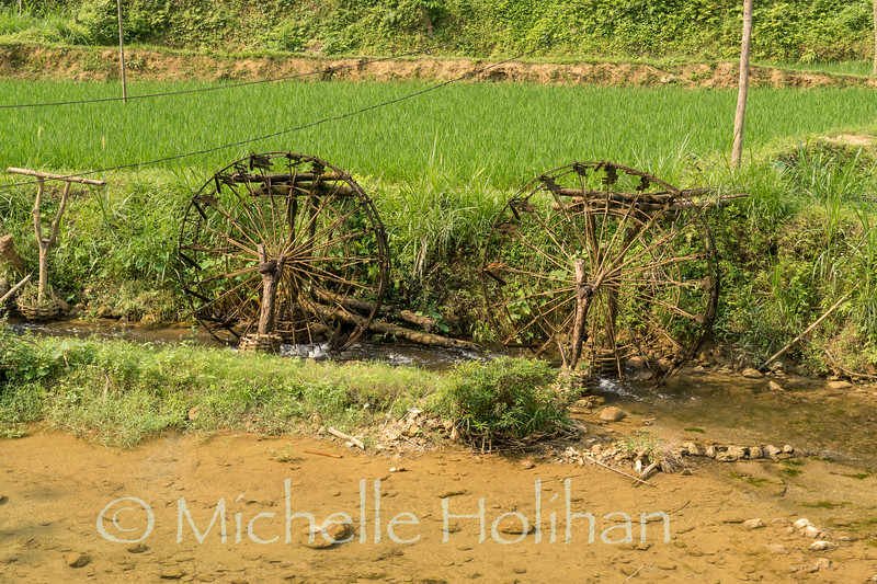 Water wheels driving gravity feed irrigation for the rice terraces at Pu Luong Nature Reserve, Vietnam