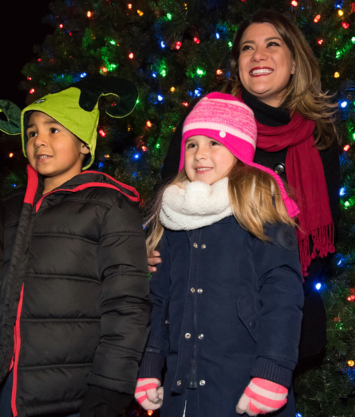 11/29/18  Wesley Bunnell | Staff   New Britain held their tree lighting ceremony with a visit from Santa on Thursday evening at Central Park.  Gamiel Rodriguez, age 7, and Ava Scofield, age 5, stand with Mayor Erin Stewart after helping push the tree lighting button.