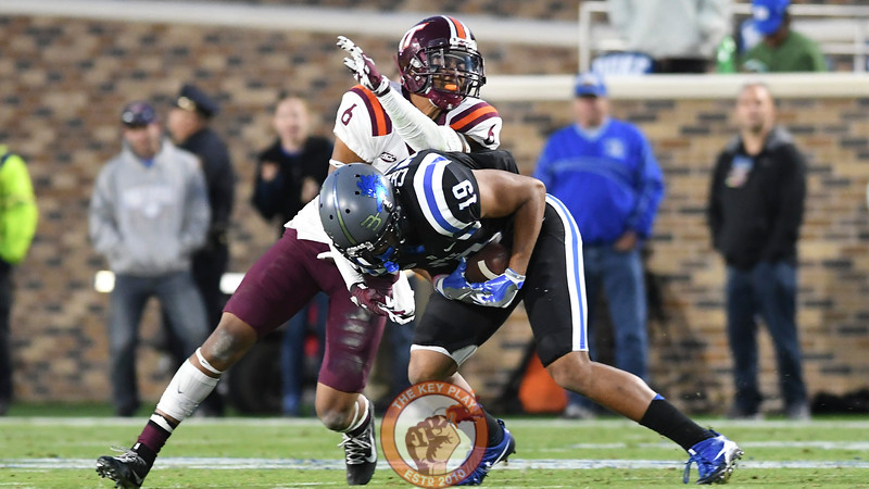 Virginia Tech safety Mook Reynolds (6) wraps up Duke wide receiver Quay Chambers (19) following his reception. (Michael Shroyer/TheKeyPlay.com)