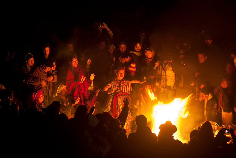 . People take part in a ceremony at the Iximche archeological site to mark the end of the 13th Oxlajuj B\'aktun in Tecpan, Guatemala, early Friday, Dec. 21, 2012. The end of the 13th Oxlajuj B\'aktun marks a new period in the Mayan calendar, an event only comparable in recent times with the new millennium in 2000. While the Mayan calendar cycle has prompted a wave of doomsday speculation across the globe, few in the Mayan heartland believe the world will end on Friday. (AP Photo/Moises Castillo)