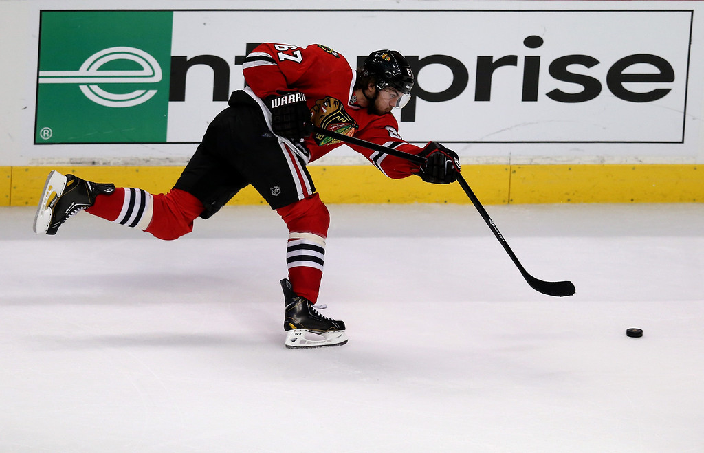 . CHICAGO, IL - JUNE 08:  Michael Frolik #67 of the Chicago Blackhawks breaks his stick on a shot attempt against the Los Angeles Kings during Game Five of the Western Conference Finals of the 2013 NHL Stanley Cup Playoffs at United Center on June 8, 2013 in Chicago, Illinois.  (Photo by Jonathan Daniel/Getty Images)