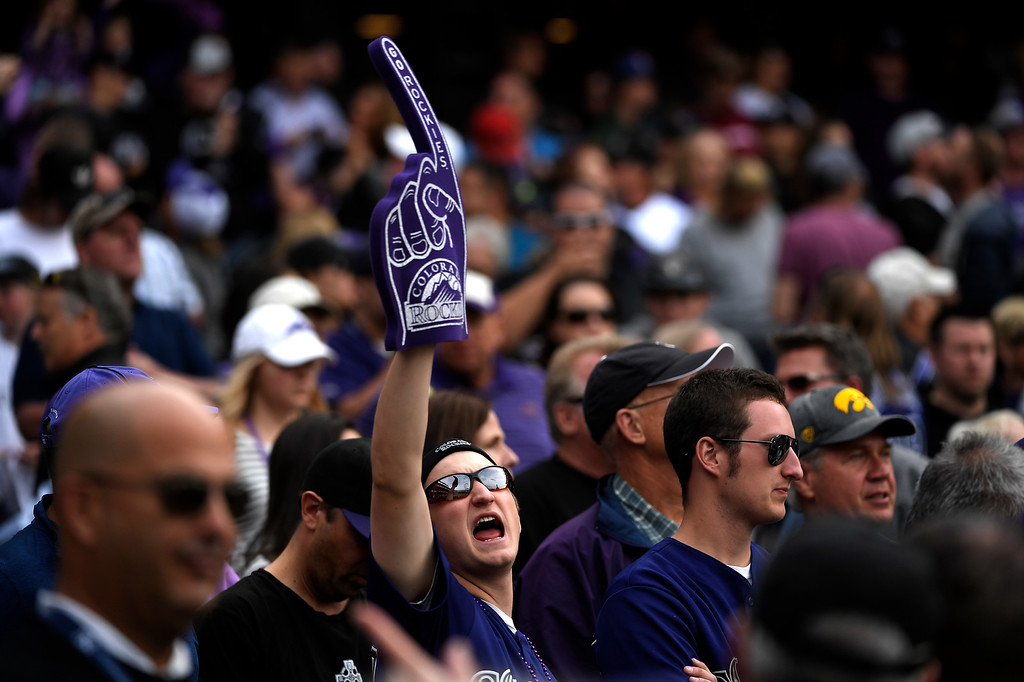 . Denver, CO - ARRIL 08: A die hard Rockies fan cheers on in the late innings of their home opening loss 13-6 to the San Diego Padres at Coors Field. April 08, 2016 in Denver, CO. (Photo By Joe Amon/The Denver Post)