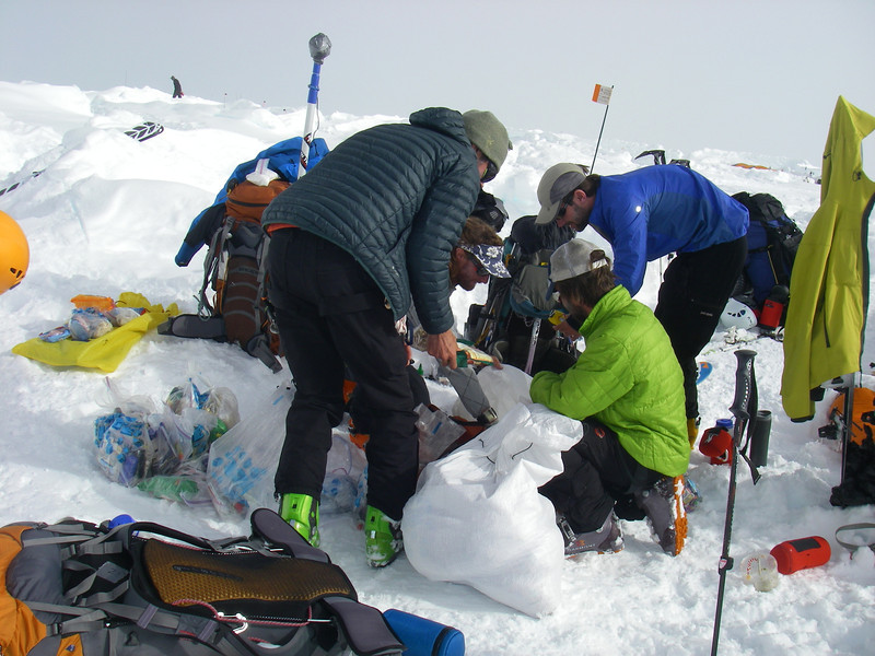 We unpacked about 100 pounds (~45kg) of high quality food to throw away in crevasse!?! From left: John DM (standing), Durny, Doug, and John W (standing).