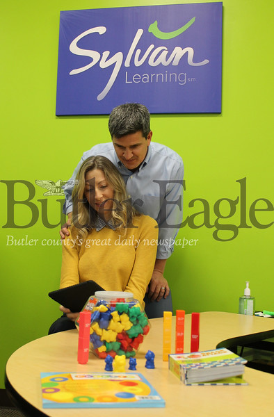 """BIZ Sylvan"" Option 2: ""Andrea and David Shilling opened a Sylvan Learning center in Cranberry Township's Regional Learning Alliance Feb. 6. The couple hopes to build confidence in local students by providing them with supplemental learning resources and helping them become successful learners."" Photo by Samantha Beal."