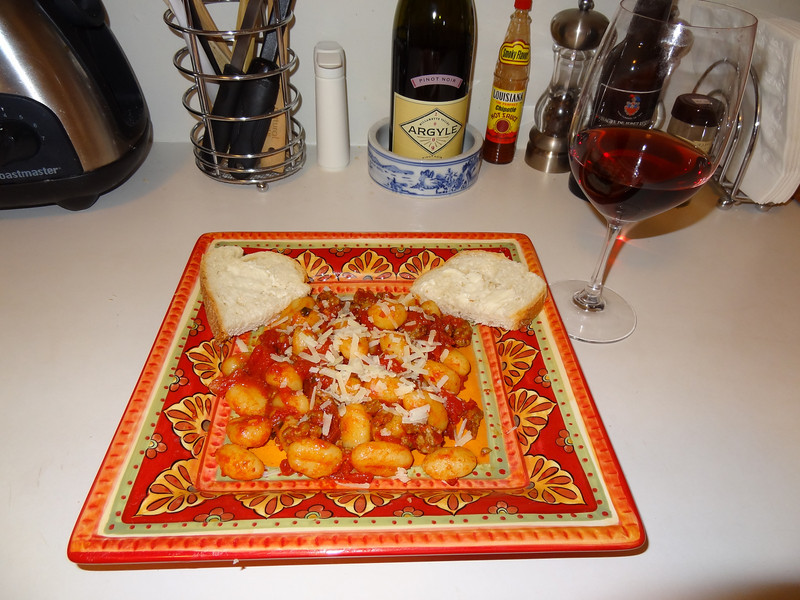Country style Sardinian gnocchi with homemade sausage sauce - malloreddus pasta with crumbled Italian sausage, fennel, saffron, tomatoes, sun dried tomatoes, garlic, fresh basil leaves and Pecorino cheese.