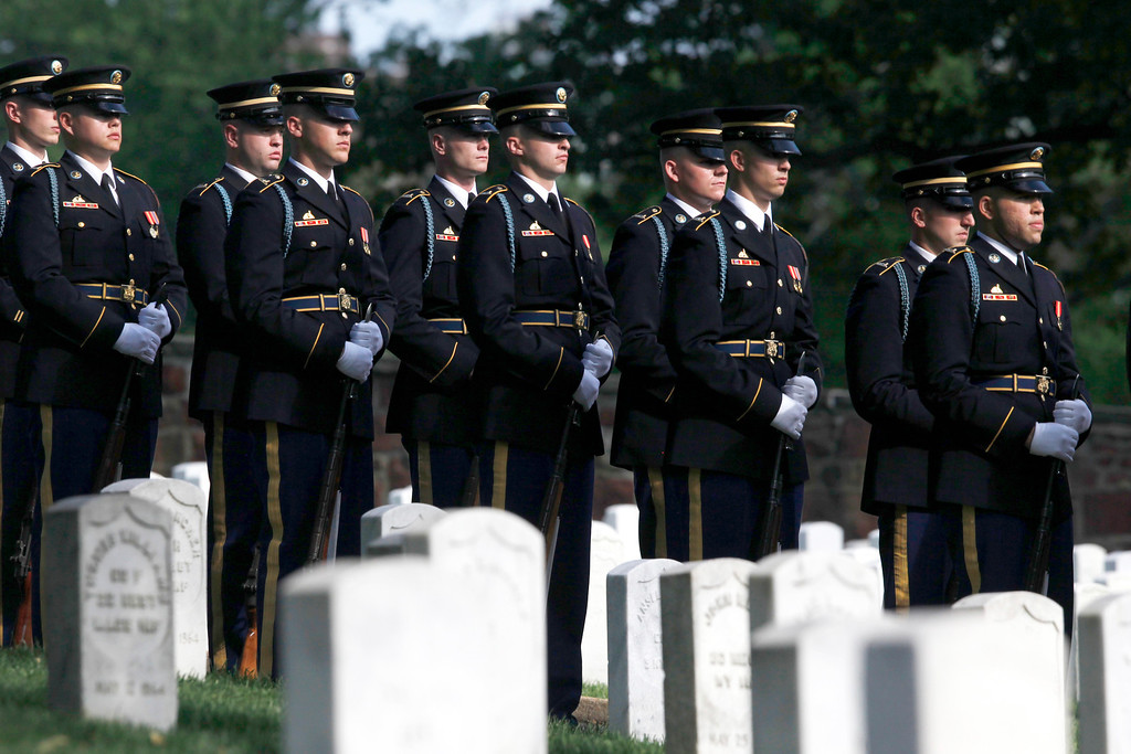 . U.S. Army honor guard members stand near the gravesite of Army Pvt. William Christman, who was the first military burial at the cemetery, marking the beginning of commemorations of the 150th anniversary of Arlington National Cemetery in Arlington, Va., Tuesday, May 13, 2014. (AP Photo)