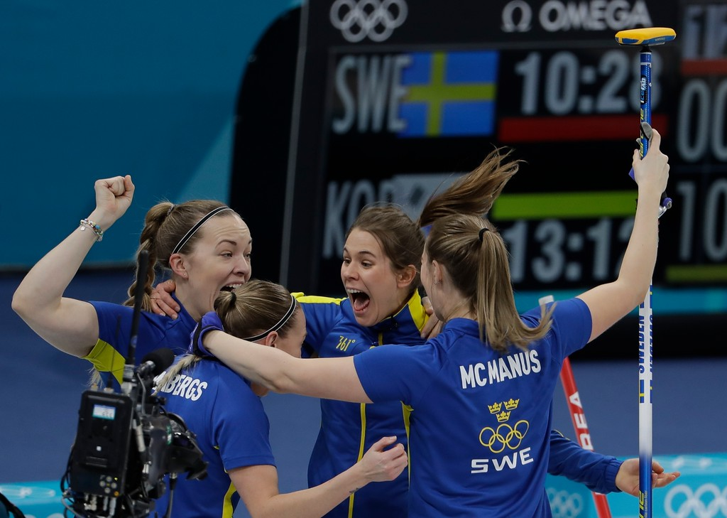 . Sweden celebrates after winning the gold medal in their women\'s curling final in the Gangneung Curling Centre at the 2018 Winter Olympics in Gangneung, South Korea, Sunday, Feb. 25, 2018. (AP Photo/Natacha Pisarenko)