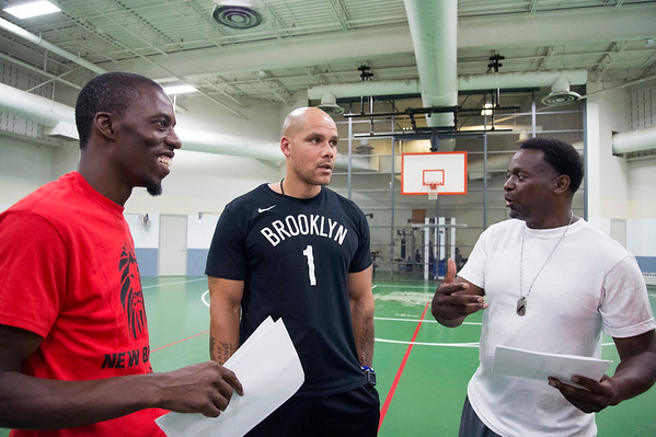 08/14/19 Wesley Bunnell | StaffrrThe Manson Youth Institution is implementing a basketball league, based off the New Britain Legacies Youth Development & Basketball Program, for inmates aged 14 to 21 to have a chance to play organized basketball with the qualification that inmates abide by the strict rules of the facility. Deivone Tanksley, L, founder of the Legacies program, speaks with correctional officers and program coaches Derek Glasper, middle, and Tim Thomas on August 14, 2019. r