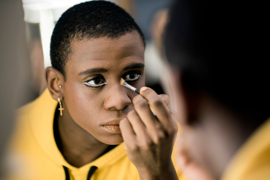 . In this Tuesday, Sept. 19, 2017 photo, ballet dancer Acaoa Theophilo puts on makeup before a dress rehearsal of Romeo and Juliet in Montevideo, Uruguay. Uruguay is a small country of 3.3 million people, but its ballet Director Julio Bocca has always said that he wants the local ballet company to be among the world�s top 10. (AP Photo/Matilde Campodonico)