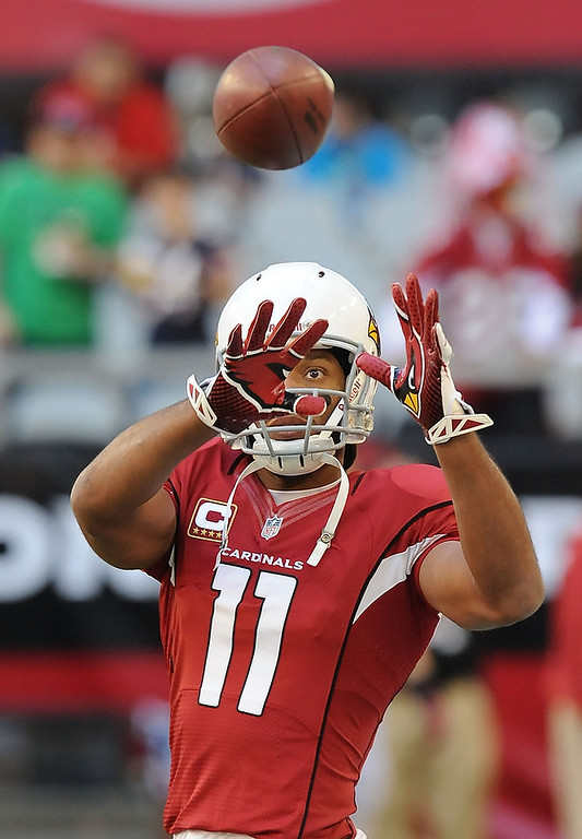 . Larry Fitzgerald #11 of the Arizona Cardinals catches a pass during pregame against the Chicago Bears at University of Phoenix Stadium on December 23, 2012 in Glendale, Arizona. (Photo by Norm Hall/Getty Images)