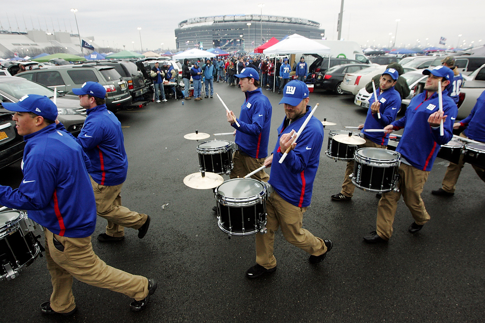 . The New York Giants Drumline marches through the parking lot at MetLife Stadium before an NFL football game between the Giants and New Orleans Saints, Sunday, Dec. 6, 2012, in East Rutherford, N.J. (AP Photo/The Record of Bergen County, Chris Pedota)