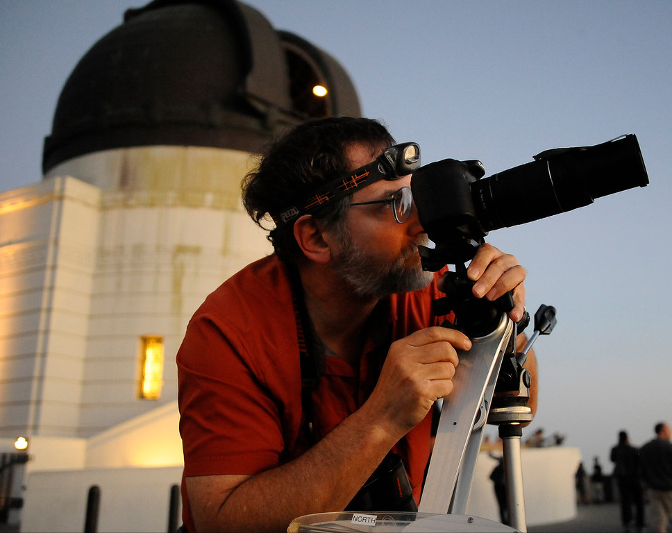 . David Beraru, from Woodland Hills, lines up his camera to photograph the comet Pan-STARRS.  The comet will be visible through the end of March.
