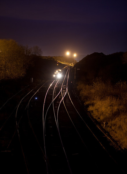 Class 66 with a rock train at night in Great Rocks Jct.