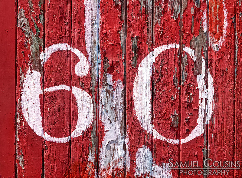 """The number """"60"""" painted on the side of box car at the Narrow Gauge Railroad"""