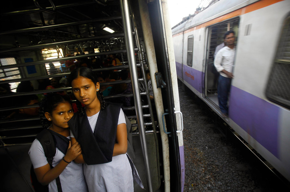Description of . Young Indian schoolgirls travel in the women's compartment of a train early morning in Mumbai, India, Thursday, Jan. 10, 2013. Five men have been charged with attacking the 23-year-old woman and a male friend on a bus as it was driven through the streets of India's capital. The woman was raped and assaulted with a metal bar on Dec. 16, 2012 and eventually died of her injuries. The case has sparked protests across India by women and men who say India's legal system doesn't do enough to prevent attacks on women. (AP Photo/Rafiq Maqbool)