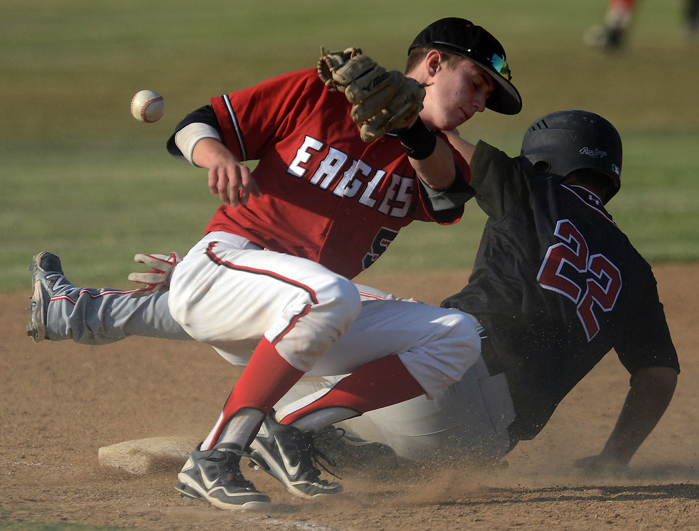 . Etiwanda\'s Brett Campagna, left, misses the throw to third as Glendora\'s Eric Flores slides in safe Friday, May 3, 2013, at Etiwanda High School in Rancho Cucamonga.(Staff photo by Jennifer Cappuccio Maher)