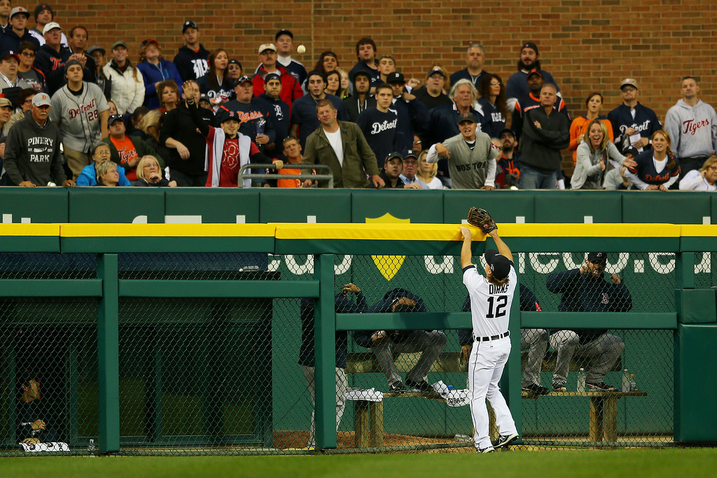 . Andy Dirks #12 of the Detroit Tigers looks on as a homerun hit by Mike Napoli #12 of the Boston Red Sox goes over the wall in the seventh inning during Game Three of the American League Championship Series at Comerica Park on October 15, 2013 in Detroit, Michigan.  (Photo by Mike Ehrmann/Getty Images)