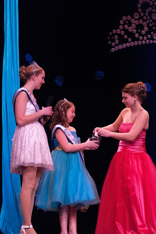 . Kayla Rice/Reformer 2013 Winter Carnival Queen Alison Cornellier and Princess Kyla Brown wait while Marissa Semenovich picks a question to answer during the 2014 Brattleboro Winter Carnival Queen\'s Pageant on Friday evening.