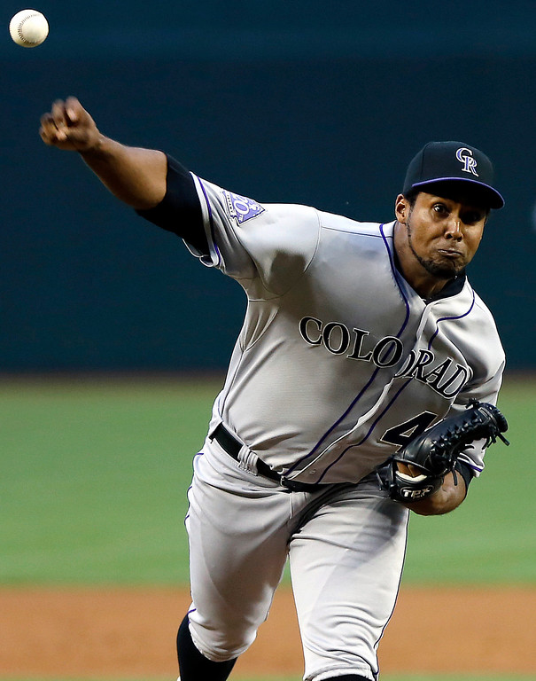 . Colorado Rockies pitcher Juan Nicasio delivers warms up against the Arizona Diamondbacks in the first inning of a baseball game on Friday, April 26, 2013, in Phoenix. (AP Photo/Matt York)