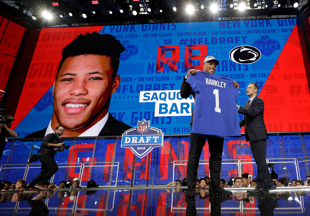 . Penn State\'s Saquon Barkley poses after being selected by the New York Giants during the first round of the NFL football draft, Thursday, April 26, 2018, in Arlington, Texas. (AP Photo/David J. Phillip)
