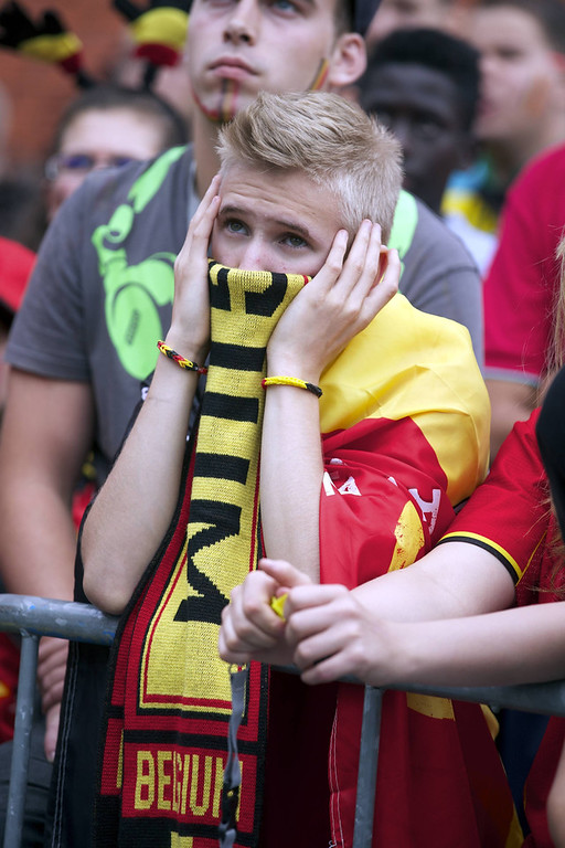 . A young Belgium\'s fan reacts as he watches the 2014 FIFA World Cup quarter final football match between Belgium and Argentina on a big screen near King Baudouin Stadium in Brussels on July 5, 2014.(NICOLAS MAETERLINCK/AFP/Getty Images)