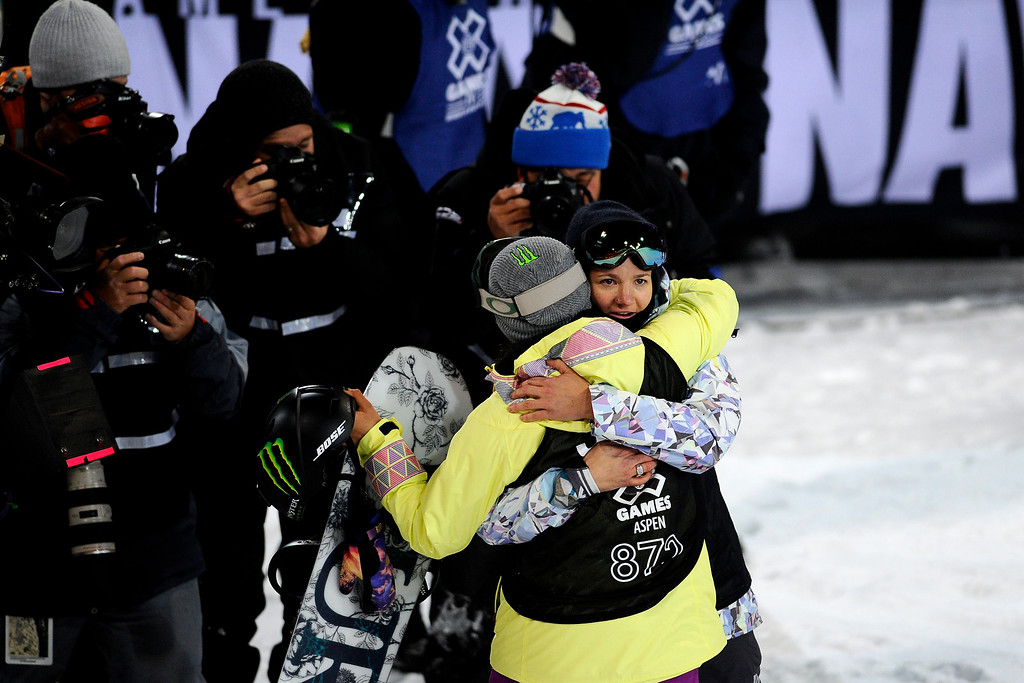 . Kelly Clark gives Chloe Kim a hug, the pair won silver and gold respectively at Women\'s Snowboard Superpipe finals, Saturday January 24, Winter X Games 2015 on Buttermilk Mountain.  (Photo By Mahala Gaylord/The Denver Post)