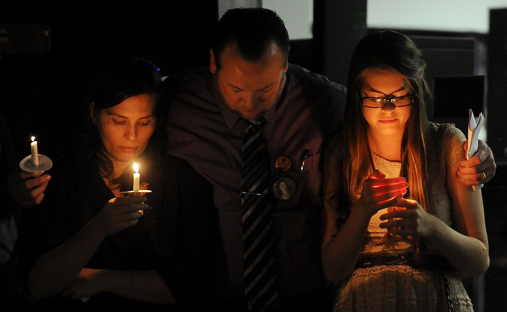 . Stephen Barber, center, father 22-year-old missing student, Sahray Barber, embraces his wife and daughter during a candlelight vigil on Friday, March 13, 2015 at the Art Institute of California Inland Empire in San Bernardino, Ca.  (Photo by Micah Escamilla/The Sun)