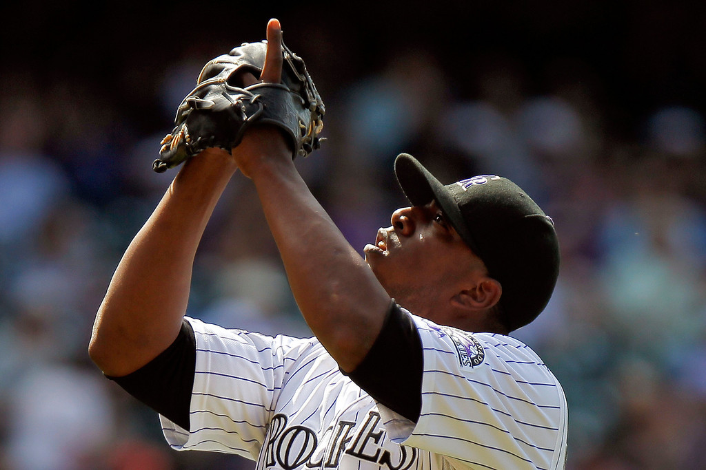 . Colorado Rockies relief pitcher Edgmer Escalona points upward after striking out Arizona Diamondbacks\' Didi Gregorius (1) during the seventh inning of a baseball game Wednesday, May 22, 2013 in Denver. The Rockies won 4-1. (AP Photo/Barry Gutierrez)