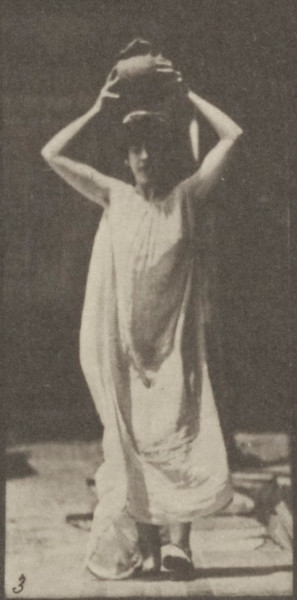 Semi-nude woman carrying a water jar on head, turning and placing it on the ground