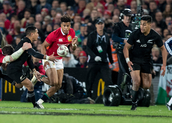 Aaron Smith offloads to Rieko Ioane during game 7 of the British and Irish Lions 2017 Tour of New Zealand, the first Test match between  The All Blacks and British and Irish Lions, Eden Park, Auckland, Saturday 24th June 2017 (Photo by Kevin Booth Steve Haag Sports)  Images for social media must have consent from Steve Haag