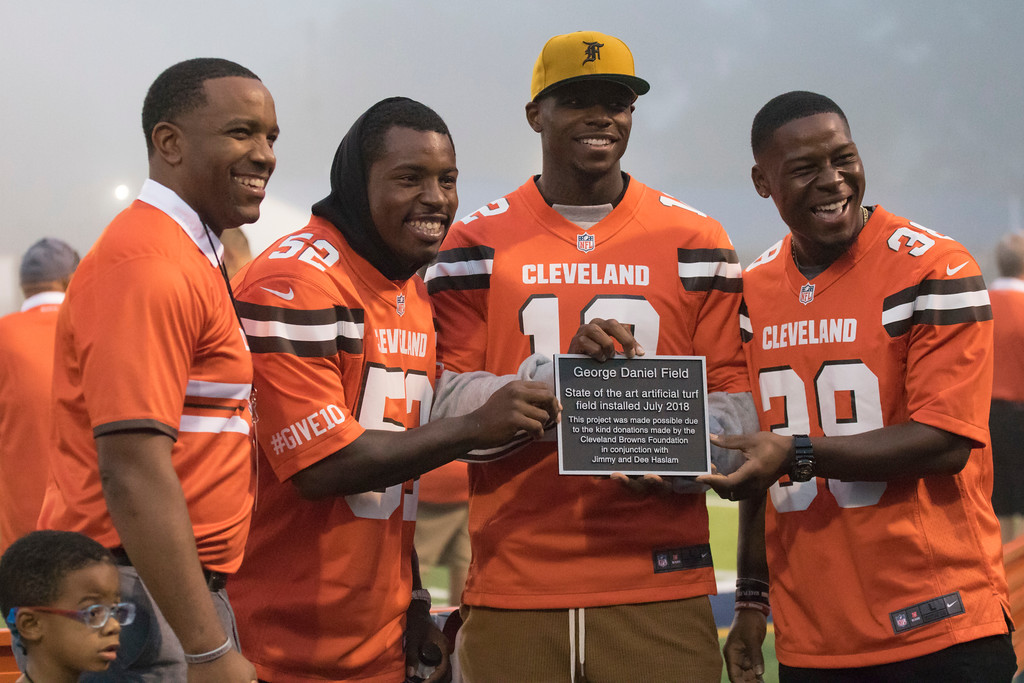 . Jen Forbus - The Morning Journal<br> Lorain CEO David Hardy and Cleveland Browns players, from left to right, James Burgess, Josh Gordon and T.J. Carrie display the new stadium plaque during a ceremony to dedicate the new turf field at George Daniel Field on Sept. 14.