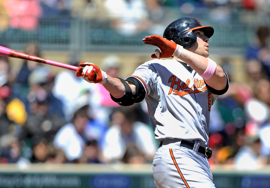. Baltimore\'s Chris Davis watches his two run homer disappear over the center field fence against the Twins during the first inning. (Photo by Hannah Foslien/Getty Images)