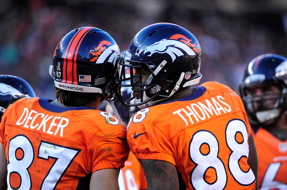 . Denver Broncos wide receiver Demaryius Thomas (88) talks with Denver Broncos wide receiver Eric Decker (87) during the first half.  The Denver Broncos vs Cleveland Browns at Sports Authority Field Sunday December 23, 2012. AAron  Ontiveroz, The Denver Post