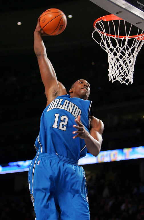 . DENVER - FEBRUARY 18:  Dwight Howard #12 of the Rookie Team goes up for a slam dunk in the game against the Sophomore Team during the got milk? Rookie Challenge, part of 2005 NBA All-Star Weekend at Pepsi Center on February 18, 2005 in Denver, Colorado. (Photo by Ronald Martinez/Getty Images)