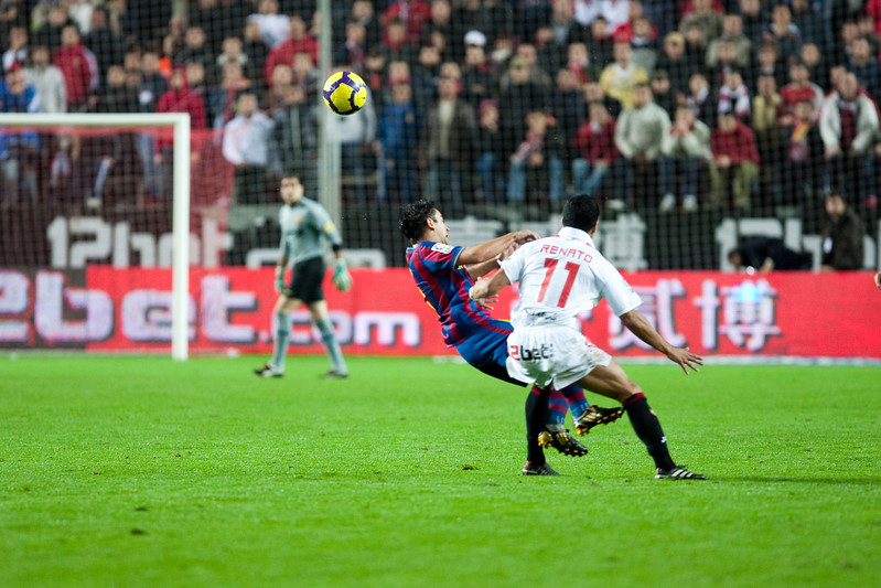 Renato committing foul on Xavi. Spanish Cup game between Sevilla FC and FC Barcelona, Ramon Sanchez Pizjuan stadium, Seville, Spain, 13 January 2010
