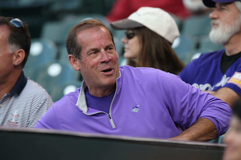 . Colorado Rockies co-owner Dick Monfort looks on as the Rockies host the San Diego Padres in the first inning of a baseball game in Denver on Saturday, Sept. 6, 2014. (AP Photo/David Zalubowski)